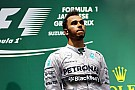 Mercedes' Lewis Hamilton wins safety car and rain delayed Japanese Grand Prix