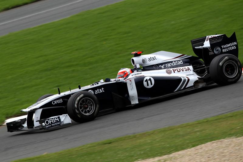 Barrichello tem corrida movimentada e elogia sistema Kers