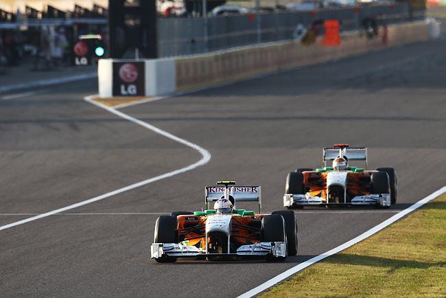 Paul di Resta e Adrian Sutil em Suzuka