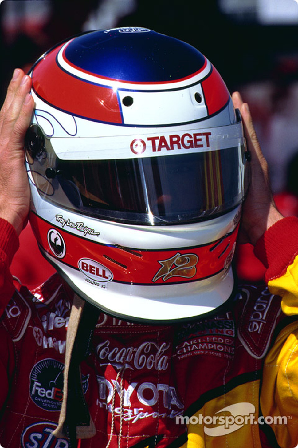 Jimmy Vasser adjusts his helmet