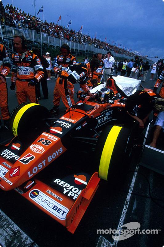 Pedro de la Rosa on the grid, under a threatening sky