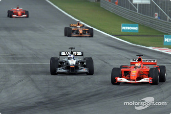 Michael Schumacher passing David Coulthard for first position