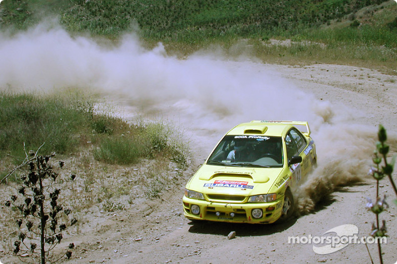 Paul Eklund and Scott Huhn in a Subaru Impreza
