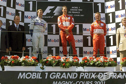 The podium: Ralf Schumacher, Michael Schumacher and Rubens Barrichello