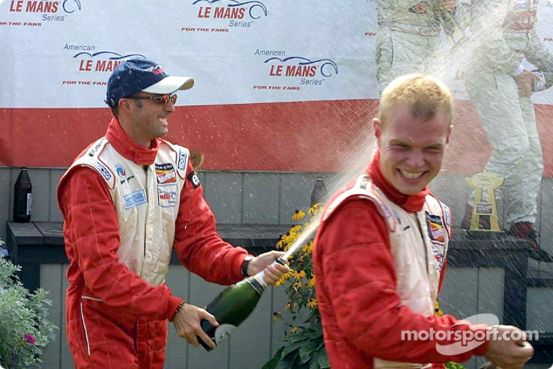 Champagne for race winners David Brabham and Jan Magnussen