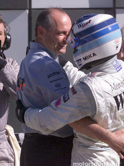 Mika Hakkinen congratulated by Ron Dennis