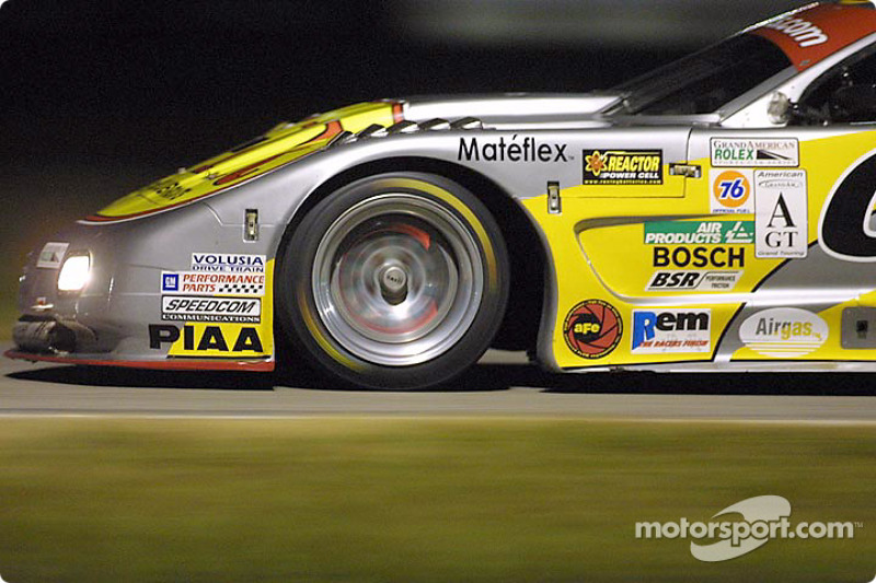The front brake rotor on the Team X-1R Corvette glows red as it races through the infield during night practice