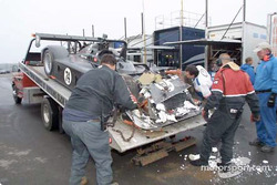 The Robinson Racing crew access the damage to its new car in the garage