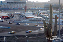 Some SGS cars weaver through the infield at Phoenix International Raceway at the start of the race