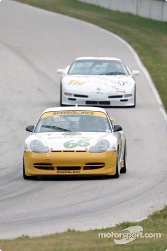 The #65 Speedsource Porsche leads a Corvette down the hill