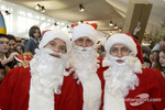 The traditional Childrens Christmas at Ferrari: Rubens Barrichello, Michael Schumacher and Luca Badoer