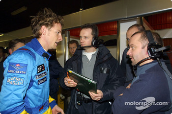 Jenson Button discussing with engineers
