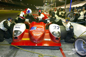 Didier Theys gets out as Mauro Baldi climbs into the #27 Judd Dallara during a late night driver change