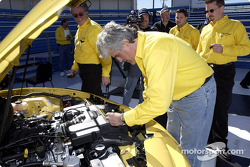 Comedian Jay Leno looks over the stock production engine in the 2002 Collector Edition Trans Am as he practices driving the car