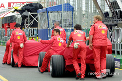 Ferrari pit crew en route to technical inspection
