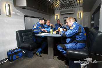 Petter Solberg and co-driver Phil Mills with the Subaru management