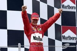 Race winner Michael Schumacher on the podium