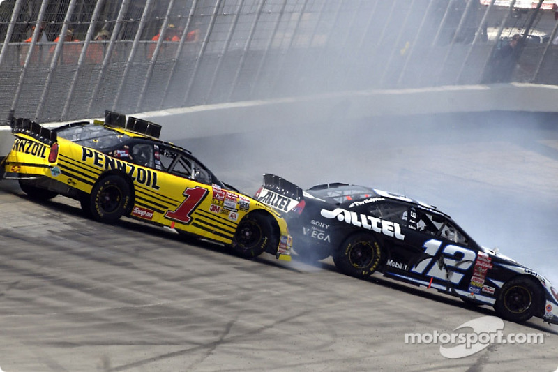 Ryan Newman and Steve Park spinning out down the back stretch