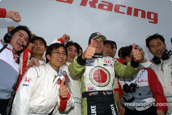 Olivier Panis celebrating with Honda crew members