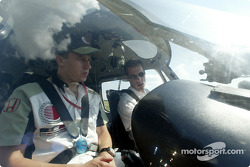 Olivier Panis learning how to fly an helicopter