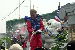 The podium: champagne for Jan Magnussen