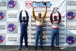 The podium: race winner Marc Breuers with A.J. Allmendinger and Rafael Sperafico