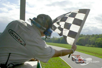 Andy Wallace in the #16 Judd-powered Crawford, fielded by the Dyson Racing Team, takes the checkered flag at the VIR 500