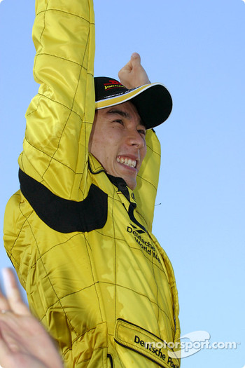 Takuma Sato celebrates his first points in Formula 1