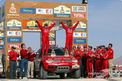 Winners Hiroshi Masuoka and Andreas Schulz celebrate victory