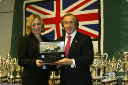 Sir Jackie Stewart and the BRDC trophy winner Johann Gibson. Johann won the replica of the 6 wheel Tyrrell.