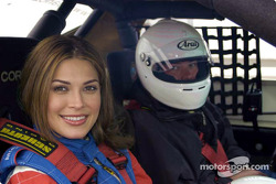 Miss Universe Justine Pasek takes a ride around the 2.54-mile Road Atlanta road course in a Panoz GT-RA by one of the Panoz Racing School instructors