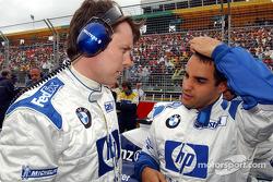 Sam Michael and Juan Pablo Montoya on the starting grid