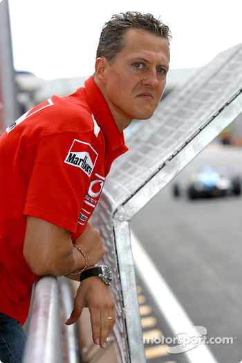 Michael Schumacher watches support races