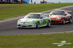 Jack Crocker (51) being pursued by Scott Shearman during Carrera Cup support race