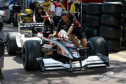 Minardi team members on pitlane