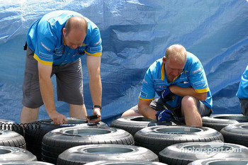 Renault F1 team members prepare tires