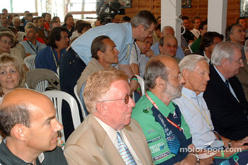 Le Mans awards ceremony: the crowd, with Don Panoz, Henri Pescarolo and Paul Frere in the first row
