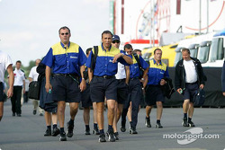 Michelin team members leave the track
