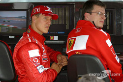 Michael Schumacher watches qualifying session