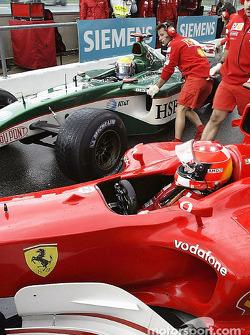 Michael Schumacher and Mark Webber collide on pitlane