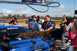 All eyes were on Stone Bros Marcos Ambrose as he is congratulated by Brett Murray for taking pole