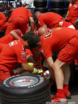 Ferrari team members get ready for pitstop practice