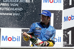 The podium: champagne for Jarno Trulli