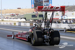 Kenny Bernstein backs his dragster into position
