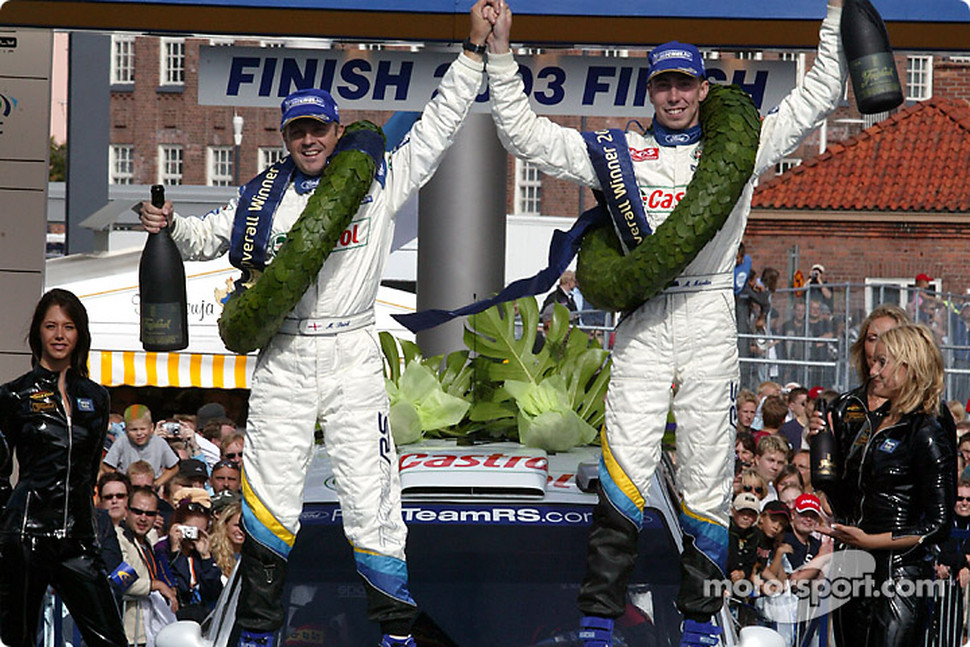 The podium: Markko Martin and co-driver Michael Park celebrate victory
