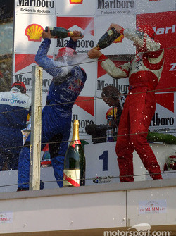 The podium: champagne for Christian Klien, Nelson A. Piquet and Ryan Briscoe