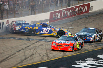 Steve Park and Kyle Petty tangle while Jeff Gordon and Mark Martin sneak by