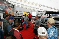 Peter Cunningham, TeamRTR owner, explains World Challenge racing to a group of fans