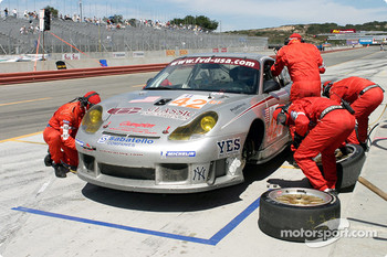 #42 Orbit Racing Porsche 911 GT3RS during a pit stop