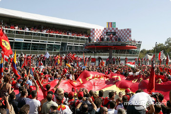 Tifosi cheer race winner Michael Schumacher on the podium